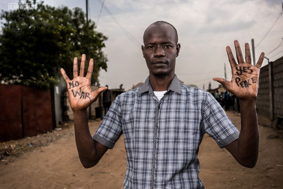 "<strong>Thomas Dai, Juba</strong> <br><i>""No war, yes peace""</i><br><br>Thomas, a cartoonist working with Juba Monitor, has b"