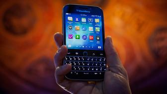 The BlackBerry Ltd. Classic smartphone is displayed for a photograph during an event in New York, U.S., on Wednesday, Dec. 17, 2014. BlackBerry Ltd. is going back to its roots with a keyboard-equipped phone that looks like the original 'crackberrys' that made the Canadian smartphone maker a household name. Photographer: Michael Nagle/Bloomberg via Getty Images