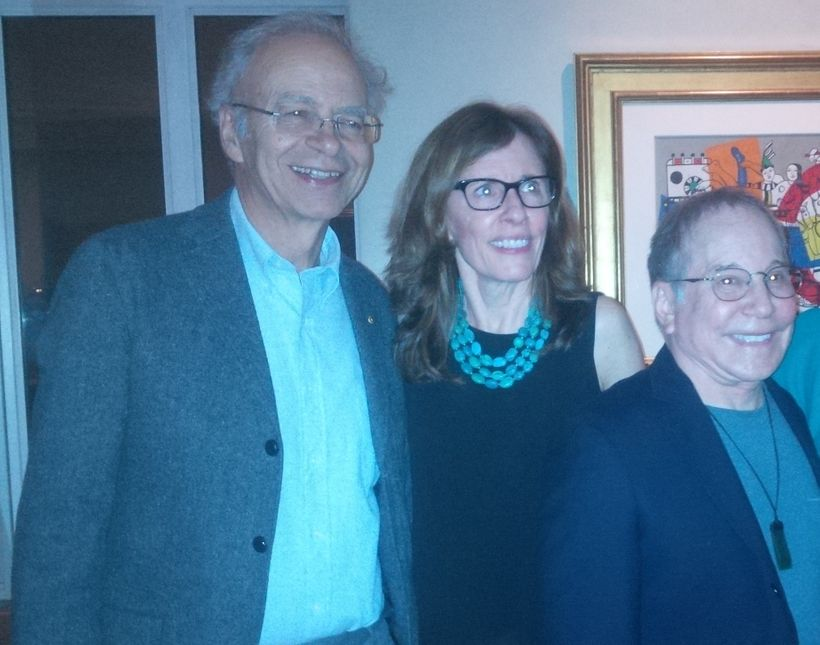 L-R: Peter Singer, Fistula Foundation CEO Kate Grant, and singer Paul Simon pose for a photo at a private benefit concert for