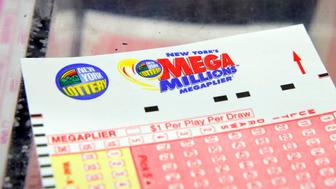 A ticket is seen ahead of the Mega Millions lottery draw which reached a jackpot of $415 Million in Manhattan, New York, U.S., July 1, 2016.  REUTERS/Andrew Kelly