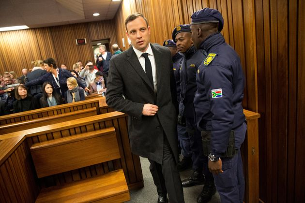 Oscar Pistorius arrives for sentencingat the North Gauteng High Court in Pretoria, South Africa,...