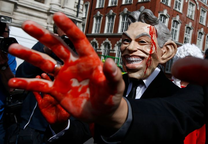 A demonstrator wearing a mask to impersonate Tony Blair protests before the release of the Chilcot report into the Iraq war,