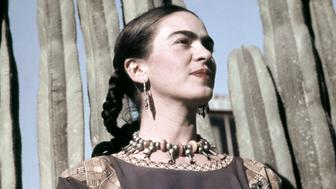 MEXICO CITY - CIRCA 1940: Artist Frida Kahlo poses for a portrait at the home and studio she shares with her husband Diego Rivera, designed by architect Juan O'Gorman circa 1940 in the Colonia San Angel neighborhood of Mexico City, Mexico.   (Photo by Ivan Dmitri/Michael Ochs Archives/Getty Images)