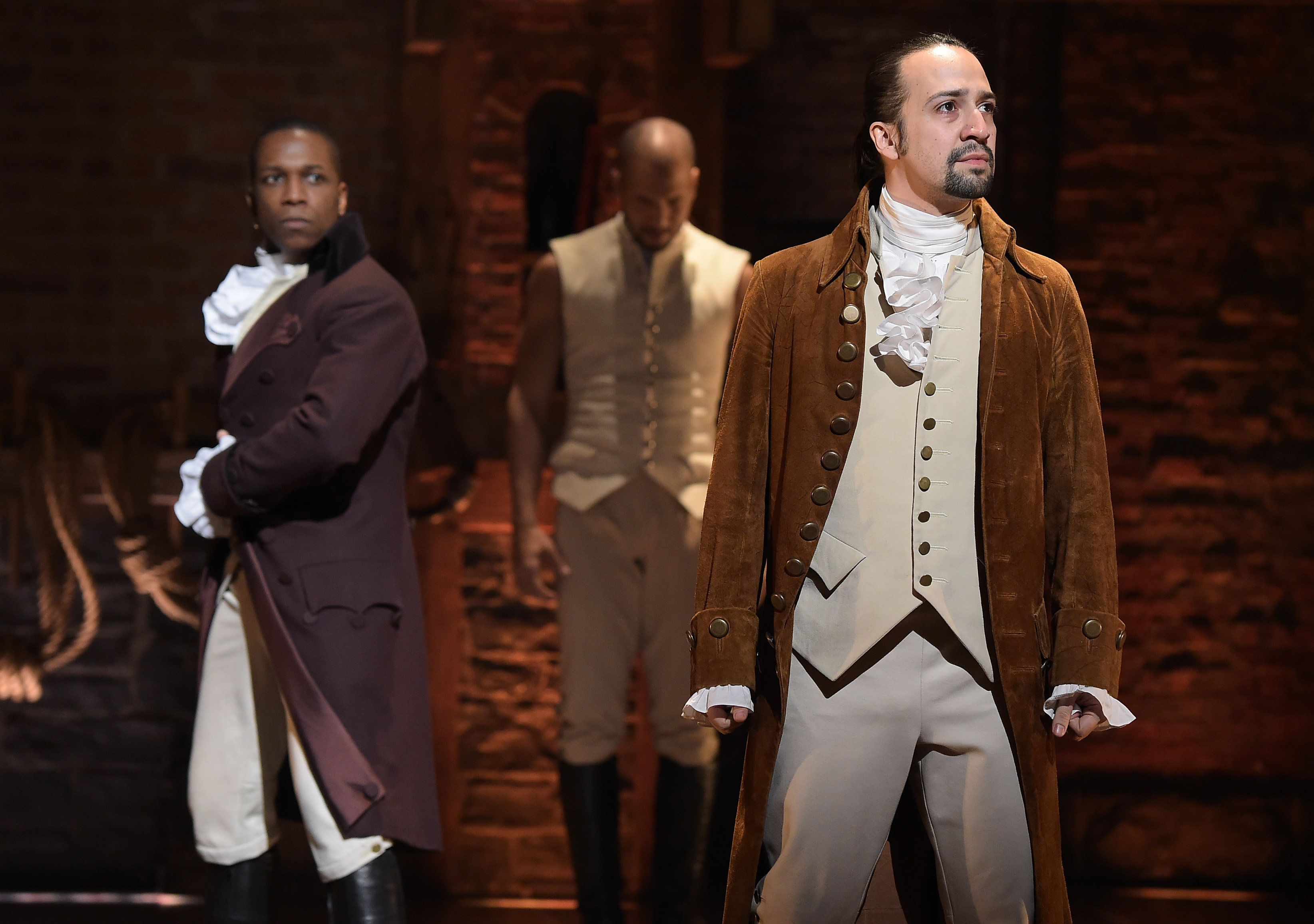 NEW YORK, NY - FEBRUARY 15:  Actor Leslie Odom, Jr. (L)  and actor, composer Lin-Manuel Miranda (R) perform on stage during 'Hamilton' GRAMMY performance for The 58th GRAMMY Awards at Richard Rodgers Theater on February 15, 2016 in New York City.  (Photo by Theo Wargo/WireImage)