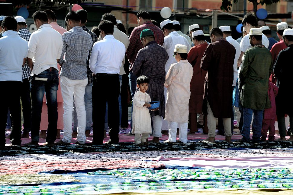 Refugees pray in Rome during Eid al-Fitr on July 6, 2016.