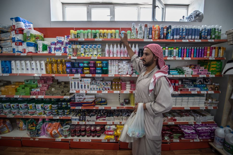 A Syrian refugee shops at a camp grocery store in the Suruc district of Sanliurfa, Turkey, on July 1, 2016.