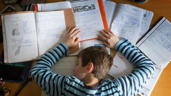 BERLIN, GERMANY - OCTOBER 27: A staged photo of a boy having fallen asleep at his desk whilst doing homework as pictured on October 27, 2013 in Berlin, Germany. (Photo by Thomas Koehler/Photothek via Getty Images)