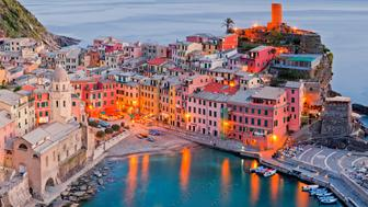 Multi - stitched panoramic image shows off color, beauty and scale of charming Vernazza, one of Cinque Terra villages.