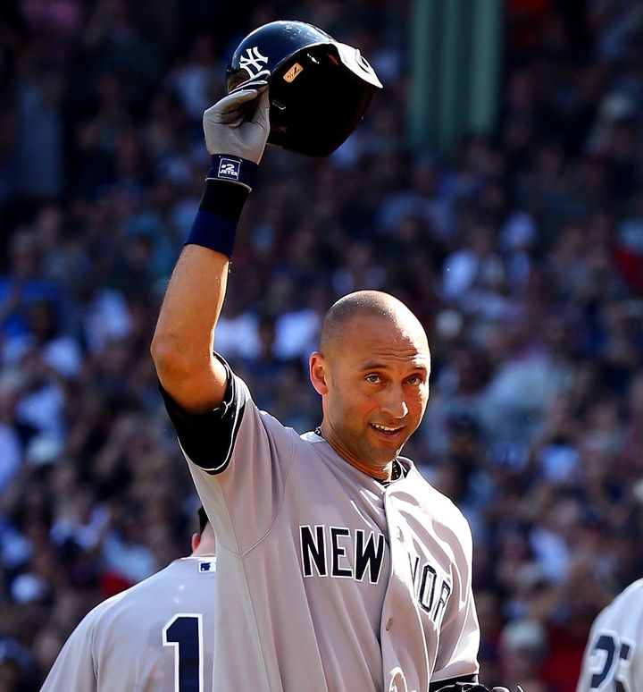 Derek Jeter waves to the crowd after hitting a single for his last career at bat against the Boston Red Sox, September 28, 20
