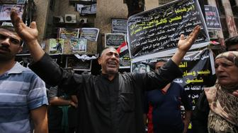 An Iraqi man, whose son has been killed in a suicide bombing that ripped through Baghdad's busy shopping district of Karrada, reacts at the site of the attack on July 6, 2016. The Baghdad bombing claimed by the Islamic State group killed at least 250 people, officials said on July 6, raising the toll of what was already one of the deadliest attacks in Iraq. / AFP / Ahmad al-Rubaye        (Photo credit should read AHMAD AL-RUBAYE/AFP/Getty Images)