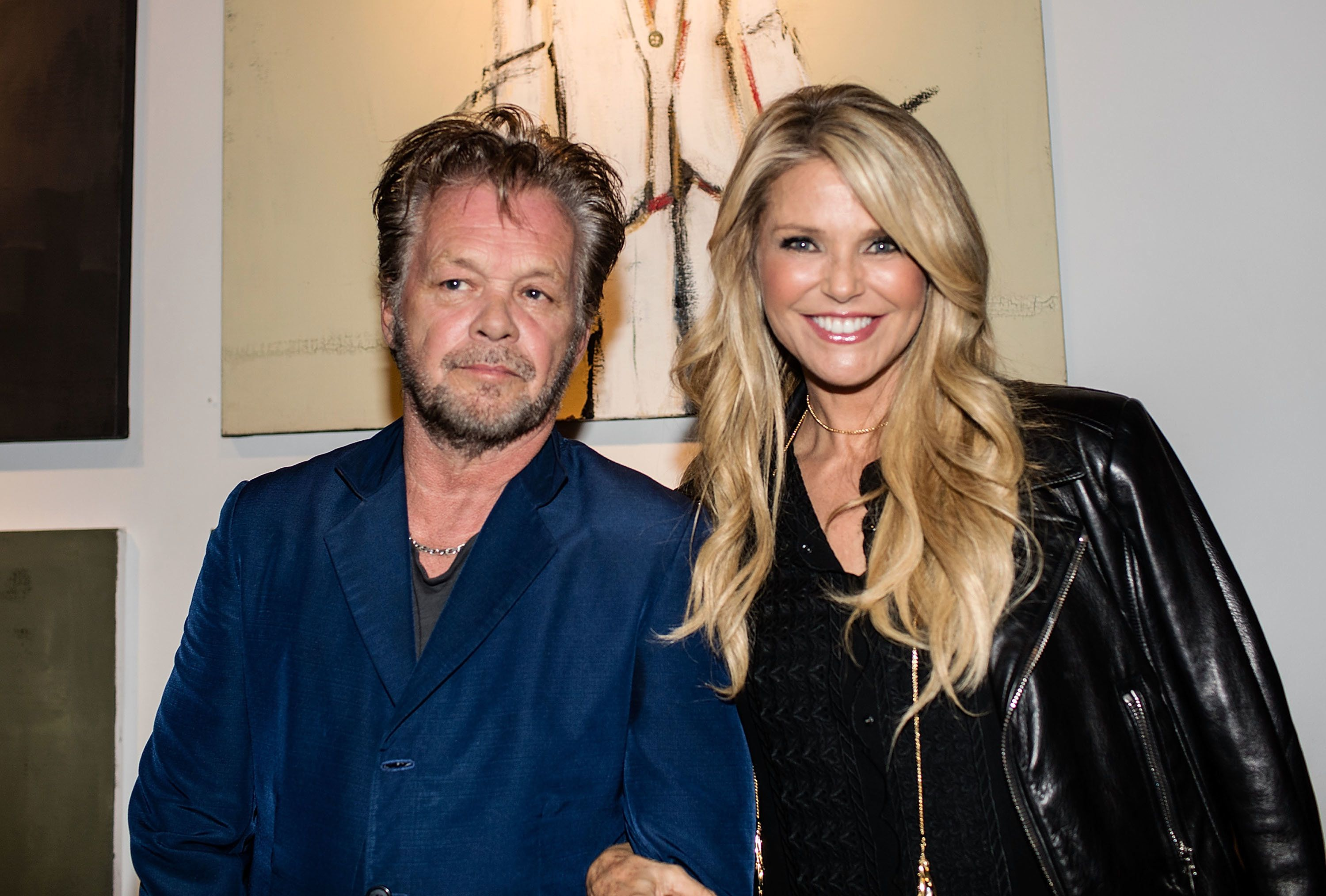 Christie Brinkley and John Mellencamp = proof that opposites attract.