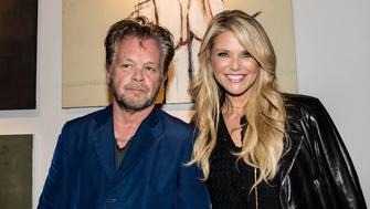 NEW YORK, NY - OCTOBER 21:  (EXCLUSIVE COVERAGE) Musician/artist John Mellencamp and model/actress Christie Brinkley attend Mr. Mellencamp's art exhibition opening 'The Isolation Of Mister' at the ACA Galleries on October 21, 2015 in New York City.  (Photo by Myrna M. Suarez/Getty Images)