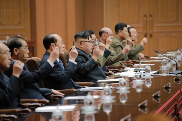 North Korean leader Kim Jong Un (C) attends the Fourth Session of the 13th Supreme People's Assembly...