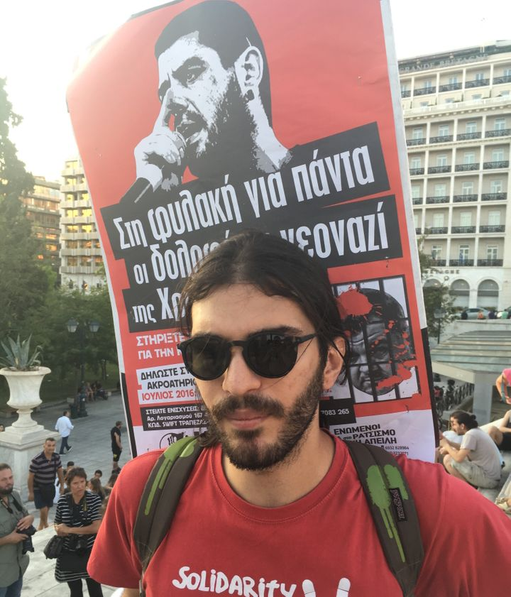 The sign on Minas Chronopoulos' back features Pavlos Fyssas, a radical anti-fascist rapper slain by members of the neo-Nazi G