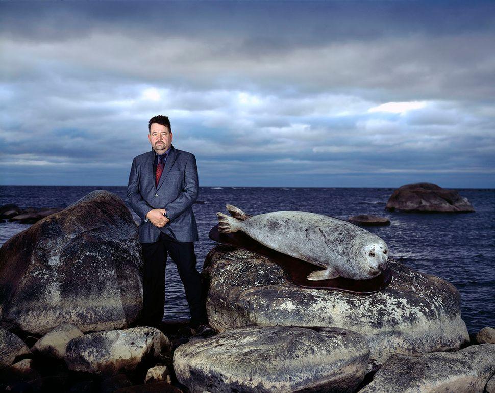 Jouni Heinikoski andgray seal.