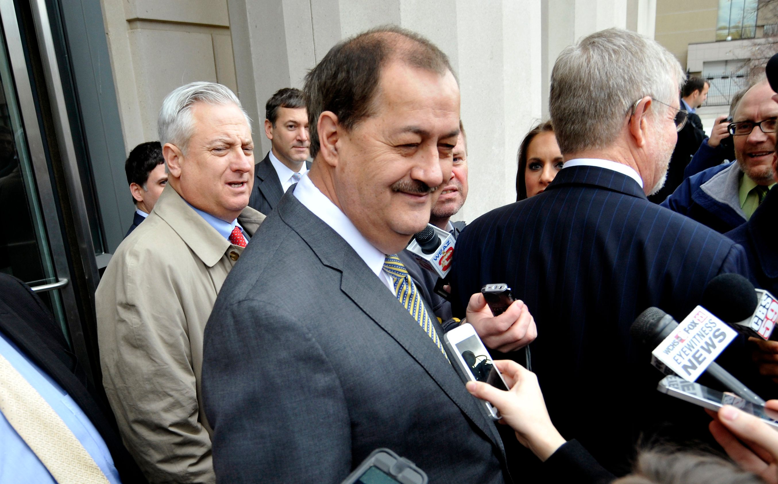 Former Massey Energy Chief Executive Don Blankenship (C) smiles outside the Robert C. Byrd U.S. Courthouse just moments after the verdict was handed down to him in Charleston, West Virginia December 3, 2015. Blankenship was found guilty in federal court on Thursday of conspiring to violate safety standards at the Upper Big Branch mine, the site of a 2010 blast that killed 29 people.    REUTERS/Chris Tilley