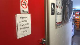A sign on the women's bathroom door at the Texaco Station and BBQ on the Brazos restaurant seems to make clear the owner's stance on the transgender restroom issue. (Gordon Dickson/Fort Worth Star-Telegram/TNS via Getty Images)