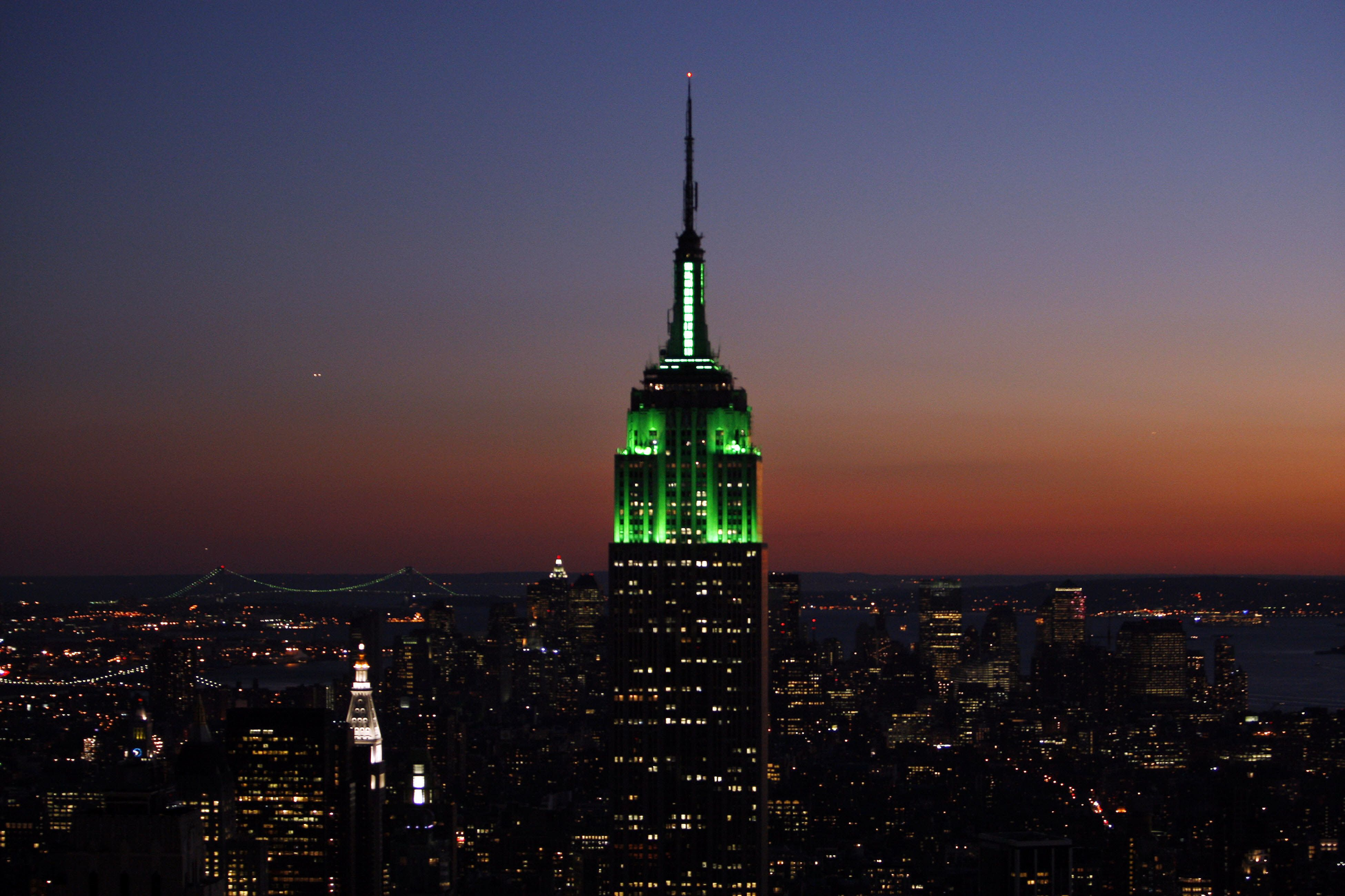 The Empire State Building is illuminated with green lights at sunset in honor of the Muslim holiday Eid-al-Fitr that marks the end of Ramadan, 12 October 2007 in New York.  (Photo credit should read STAN HONDA/AFP/Getty Images)