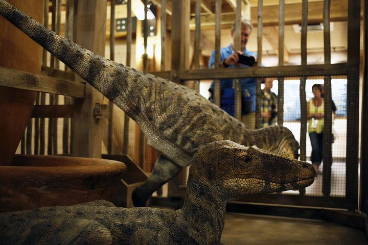 Dinosaurs on display in a cage at the Ark Encounter in Kentucky. The creationist behind the attraction claims dinosaurs