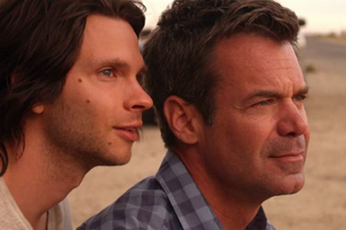 Devon Graye and Tuc Watkins in a scene from <strong><i>Retake</i></strong>