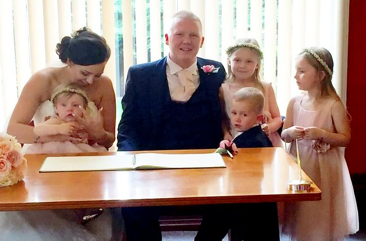 Aimee and Craig Partridge with their children on their wedding day (L to R) Nualah, one, son Harloe, two, Brogan-Lei, seven, and Niabhy, five.