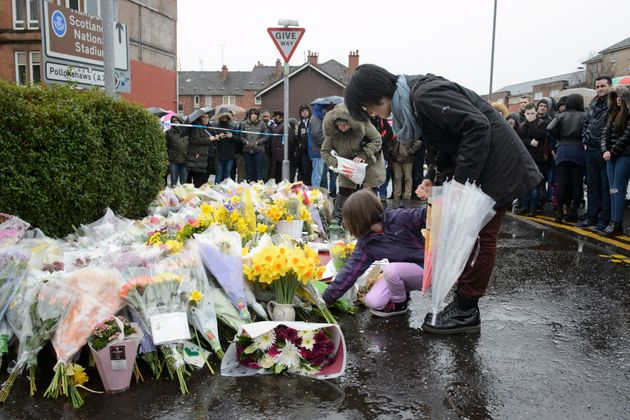 Tributes left to the shopkeeper at the
