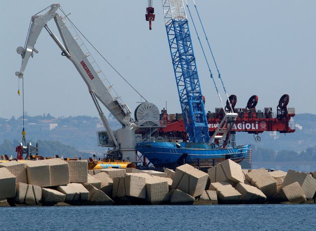 Italian teams worked this month to lift the wreck of the fishing boat that sank and drowned hundreds...