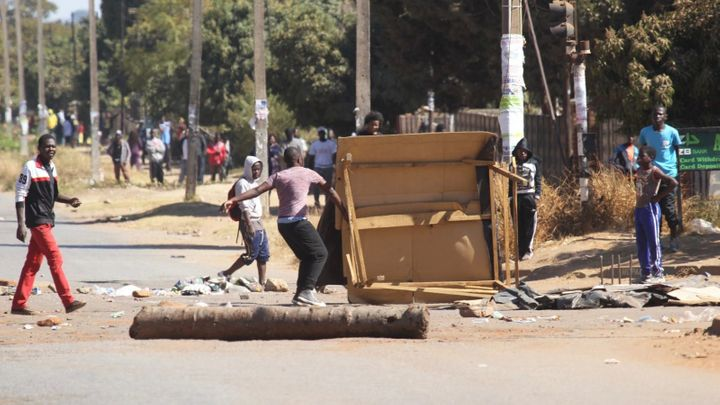 Protestors block a road leading to the city following a job boycott started via social media platforms in Harare on&nbsp