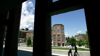 UNITED STATES - JUNE 02:  Students walk on the campus of Dartmouth College, the smallest school in the Ivy League, in Hanover, New Hampshire, U.S., on Tuesday, June 2, 2009. Dartmouth, whose endowment was valued at $3.7 billion as of June 30, likely lost about 23 percent from that point through the end of March, Moody's Investors Service said May 27.  (Photo by Cheryl Senter/Bloomberg via Getty Images)