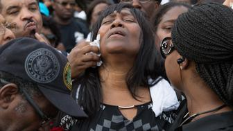 Sandra Sterling, reacts during community vigil in memory of her nephew, Alton Sterling, who was shot dead by police, at the Triple S Food Mart in Baton Rouge, Louisiana, U.S. July 6, 2016.  REUTERS/Jeffrey Dubinsky   TPX IMAGES OF THE DAY