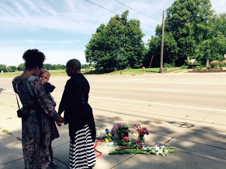 Pastor Patricia Bell (right) of St. Paul prays on July 7, 2016, with Gabriella Dunn and her children Oakland, 1, and Chloe, 4