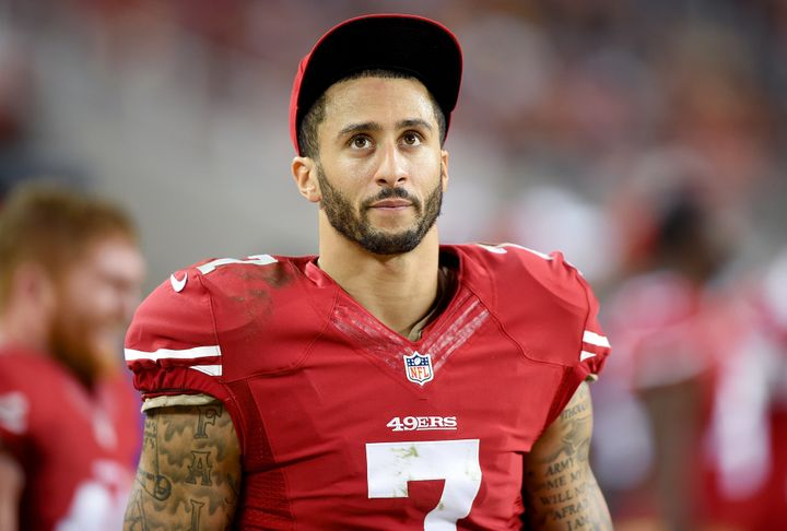 Colin Kaepernick of the San Francisco 49ers looks on from the sidelines against the San Diego Chargers, December 2014.