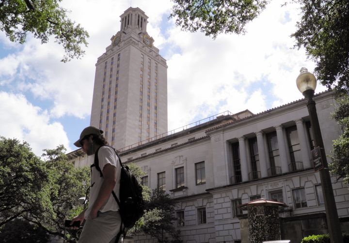 A student walks at the University of Texas campus in Austin, Texas, June 23, 2016.