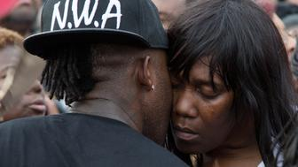 Sandra Sterling, is comforted during community vigil in memory of her nephew, Alton Sterling, who was shot dead by police, at the Triple S Food Mart in Baton Rouge, Louisiana, U.S. July 6, 2016.  REUTERS/Jeffrey Dubinsky
