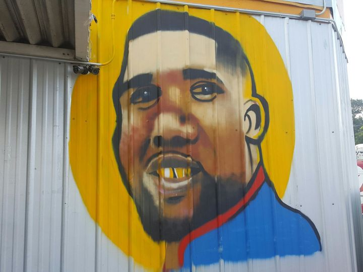 A recently painted mural of Alton Sterling graces the side of the Triple S convenience store in Baton Rouge.