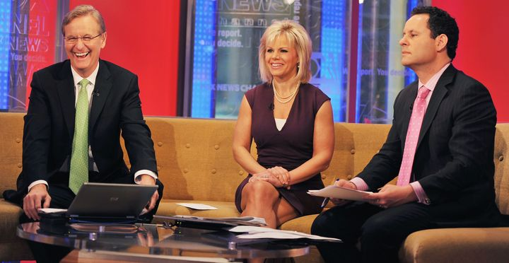 Steve Doocy, Gretchen Carlson and Brian Kilmeade at the Fox studios in 2011 in New York City.