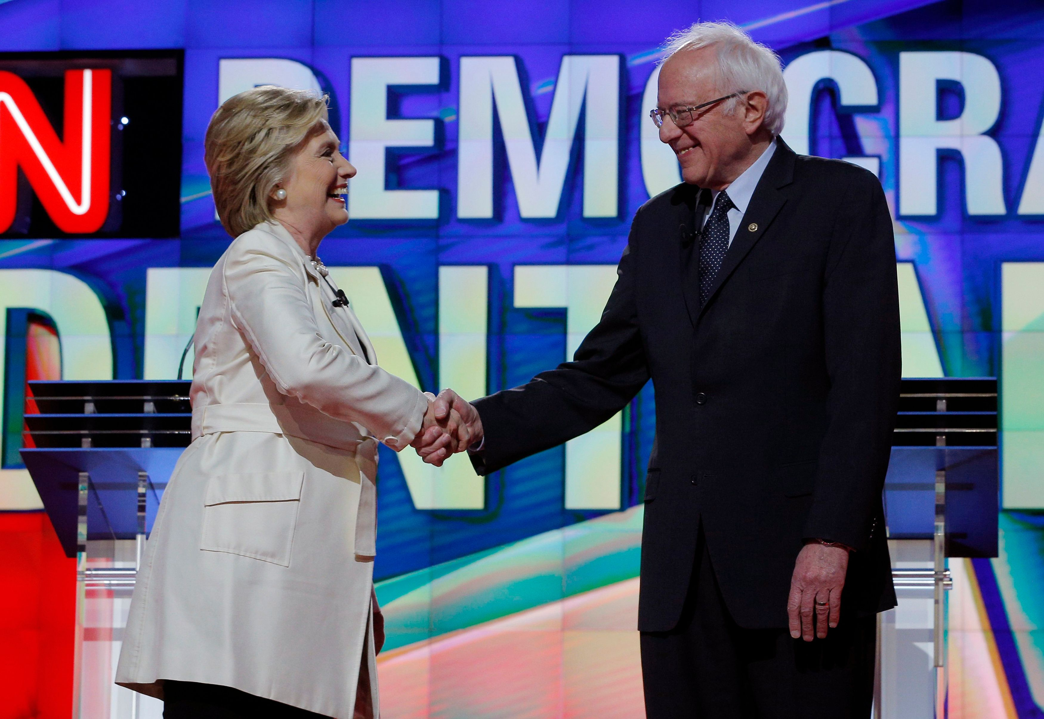 Democratic U.S. presidential candidate and former Secretary of State Hillary Clinton (L) shakes hands with Senator Bernie Sanders at the start of their debate hosted by CNN and New York One at the Brooklyn Navy Yard in New York April 14, 2016.  REUTERS/Brian Snyder