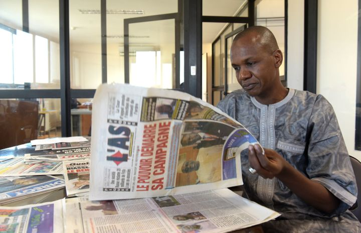 This file photo shows a journalist posing in his office in Dakar. He is one of hundreds of African journalists to have enjoye