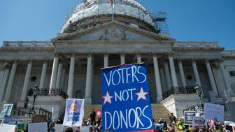 UNITED STATES - APRIL 13: Democracy Spring protesters calling for the end of big money in politics march to the Capitol steps on the East Plaza of the Capitol on Wednesday April 13, 2016.  (Photo By Bill Clark/CQ Roll Call)
