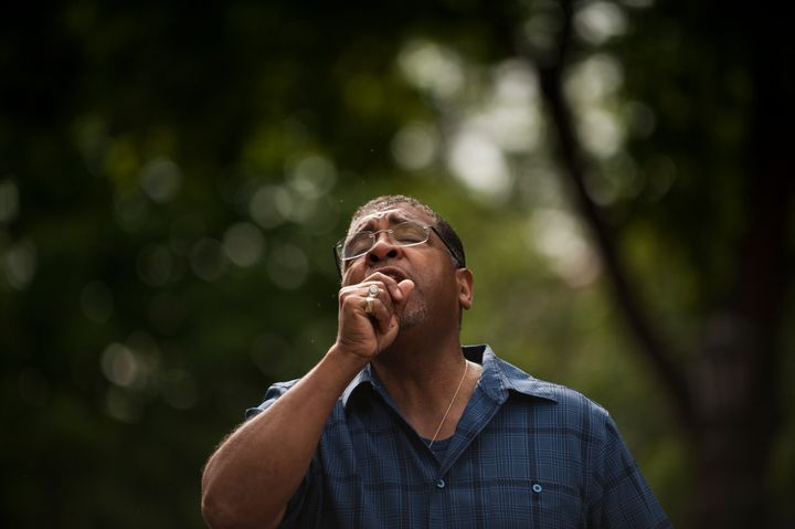 Pastor Brian Heron leads a prayer for Philando Castile outside Governor's Mansion.