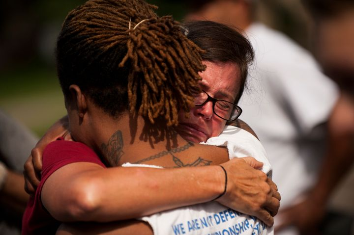 Two people embrace during a demonstration for Philando outside the Governor's Mansion.