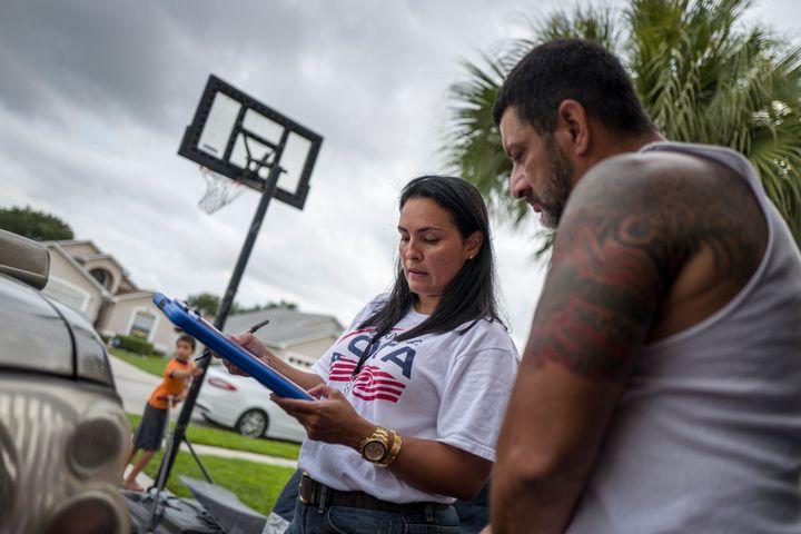 Mi Familia Vota registers voters in a Puerto Rican neighborhood in Kissimmee, Florida.