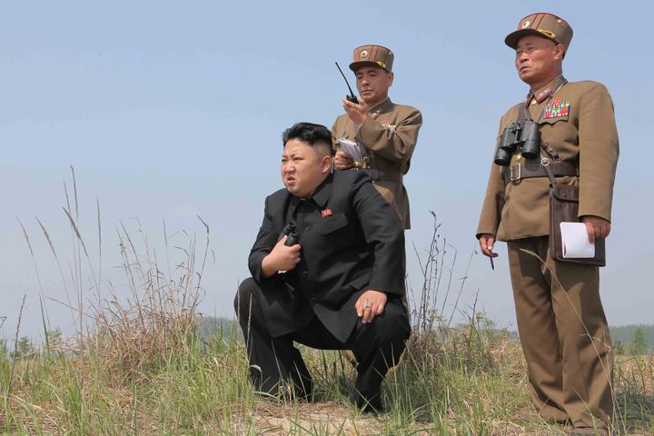 North Korean leader Kim Jong Un guides the multiple-rocket launching drill of women's sub-units under KPA Unit 851, in this u