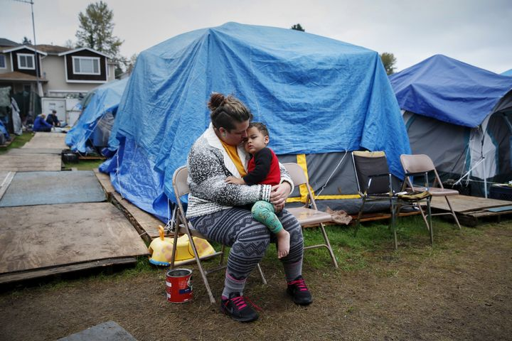 Kadee Ingram holds her son at a Tent City outside Seattle.