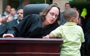 """Judge Janet Albert at Adoption Day in Court at Moultre Courthouse in Washington, DC. Photo Credit: <a href=""""https://www.flick"""