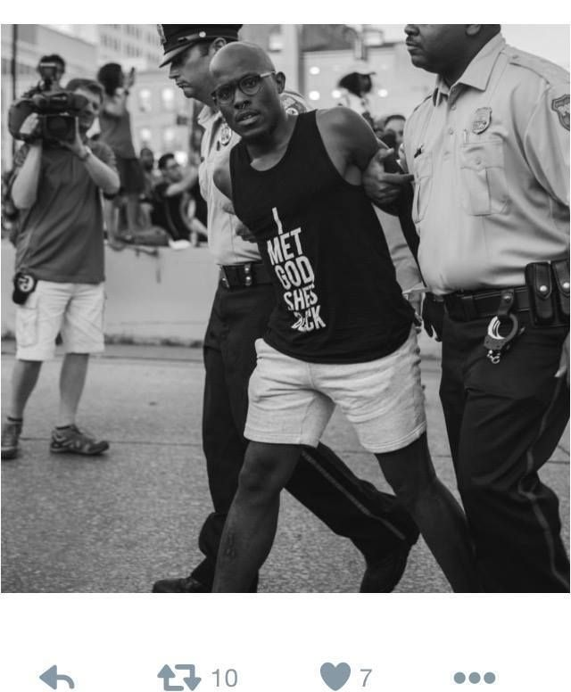 A black, gay Harlem pastor being arrested for civil disobedience after failing to disperse from obstructing a highway entranc