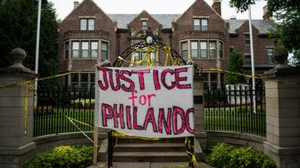 ST. PAUL, MN - JULY 07: A sign reading, 'Justice for Philando,' and police tape are draped over the entrance of the Governor's Mansion following the police shooting death of a black man on July 7, 2016 in St. Paul, Minnesota. Philando Castile was shot and killed last night, July 6, 2016, by a police officer in Falcon Heights, MN. (Photo by Stephen Maturen/Getty Images)