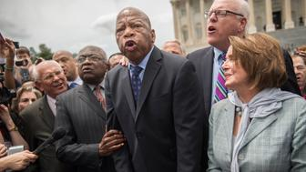 UNITED STATES - JUNE 23: From left, Reps. Paul Tonko, D-N.Y., James Clyburn, D-S.C., John Lewis, D-Ga., Joe Crowley, D-N.Y., House Minority Leader Nancy Pelosi, D-Calif., Terri Sewell, D-Ala., and Charlie Rangel, D-N.Y., sing 'We Shall Overcome' with demonstrators on the East Front of the Capitol after the House Democrats' sit-in ended on the floor, June 23, 2016. The Democrats are calling on Republicans to allow a vote on gun violence measures. (Photo By Tom Williams/CQ Roll Call)