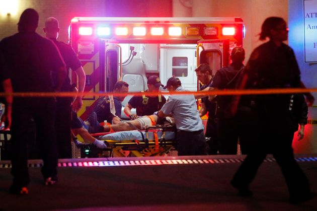 Emergency responders administer CPR to an unknown patient after gunmen opened fire during a Black Lives...