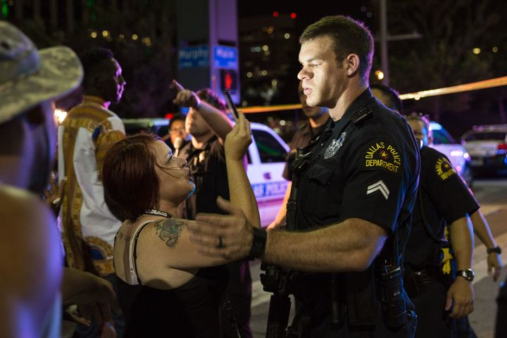 Police attempt to calm the crowd as someone is arrested following the sniper shooting in Dallas on Thursday.